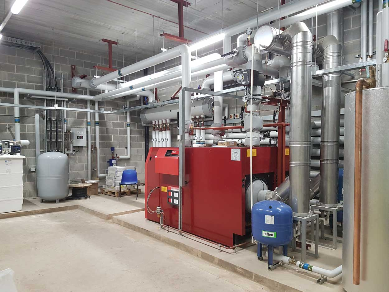 large plantroom with unit and pipework